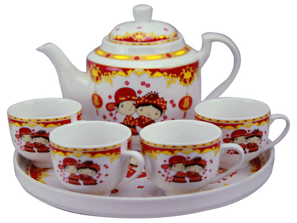 White tea pot and four tea cups with cute cartoon-style Chinese bride and groom, and red and gold design