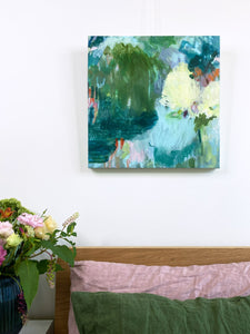 An original square format abstract landscape acrylic painting on canvas hanging above the bed styled in situ in the bedroom  olive deep blue yellow pastel blue palette by melbourne artist belinda marshall
