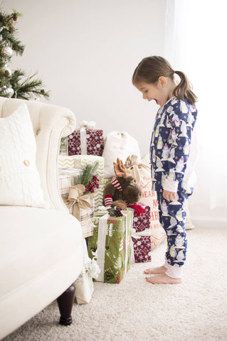 Adorable Christmas morning pajamas with a winter penguin print.
