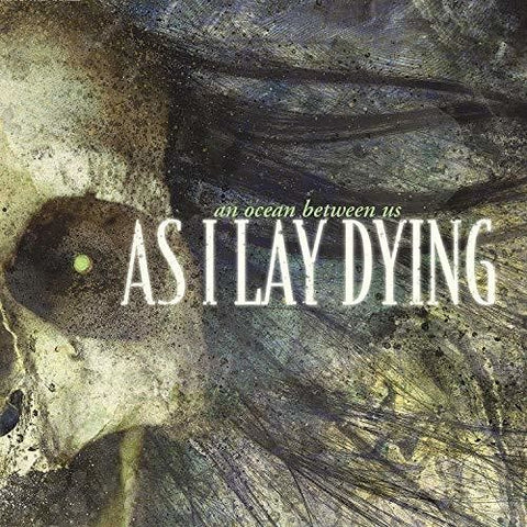 <b>As I Lay Dying </b><br><i>An Ocean Between Us</i>