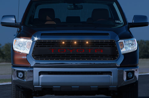 1 Piece Steel Grille for Toyota Tundra 2014-2017 - TOYOTA V3 w/ RED ACRYLIC UNDERLAY and 3 AMBER RAPTOR LIGHTS