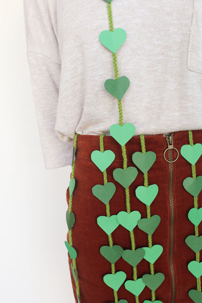 Looking for the perfect houseplant costume this Halloween that's cheap, easy, and quick? Green construction paper hearts on twine for String of Hearts costume