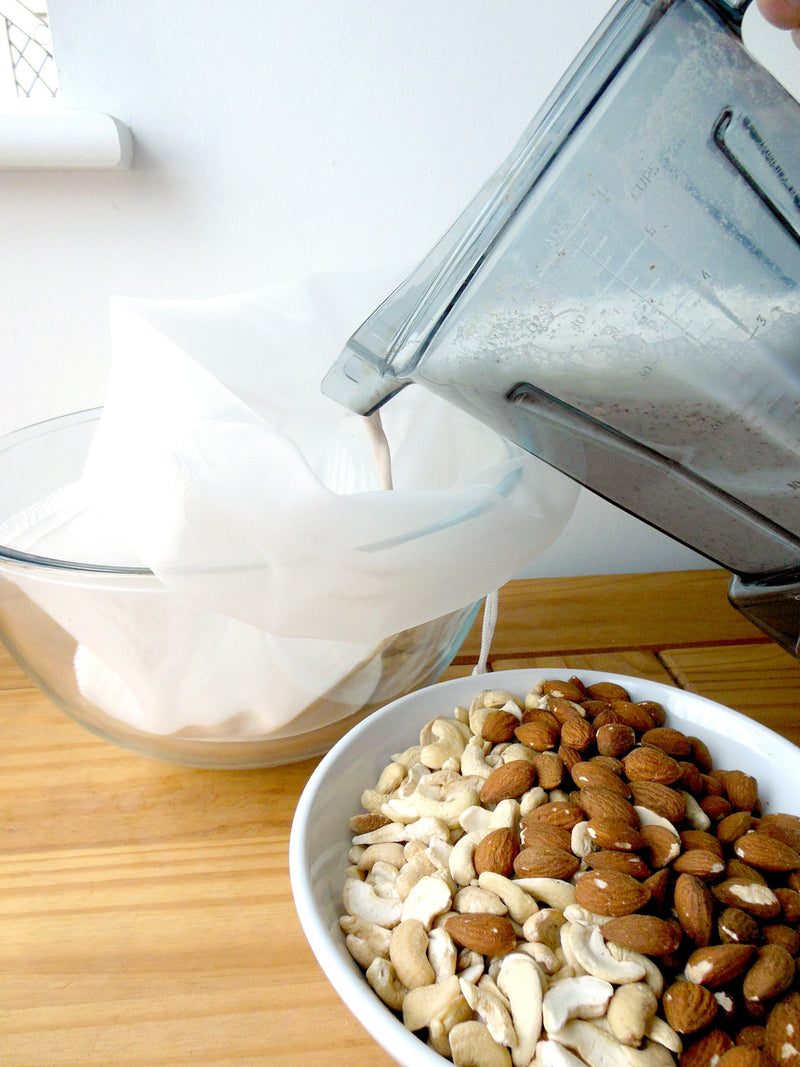 almond nut milk about to be strained through bag