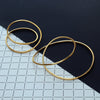 Infinity bangle - small or large - in brassPoppy Norton- Cachette