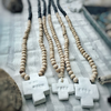 Bicolor wood necklace with engraved clay cross (various messages)Mechant Studio- Cachette