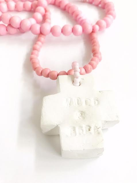 Pink wooden beads necklace with clay cross