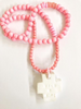 Pink wooden beads necklace with clay crossMechant Studio- Cachette