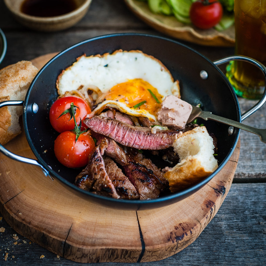 Sizzling steak and eggs