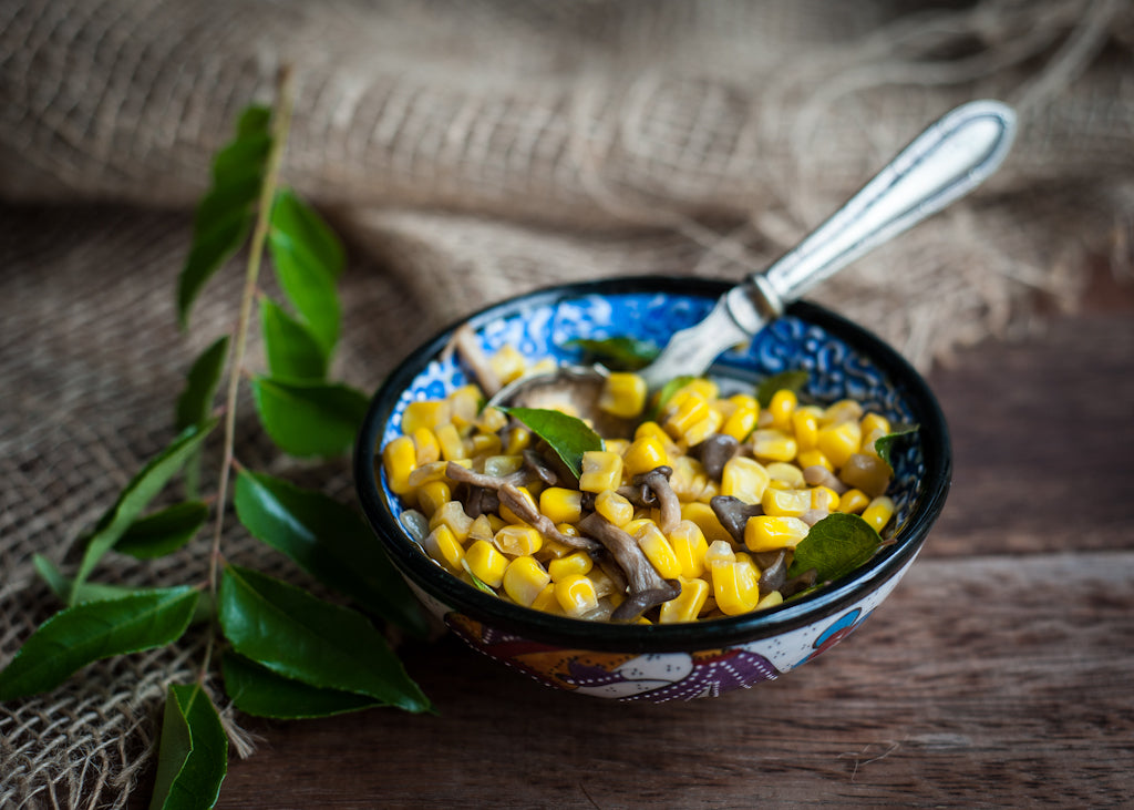 Fried corn, mushroom and curry leaves