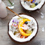 Coconut bowl of tropical fruit salad