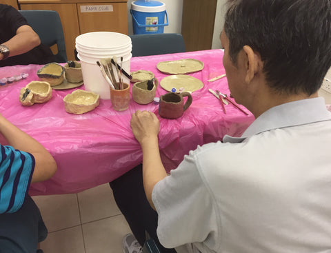 Mental health patients doing pottery