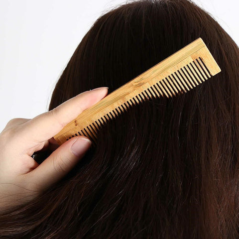 Gently brush your hair using the tail end of your comb
