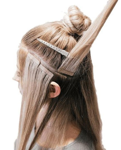 Tape-in hair extensions for a seamless look