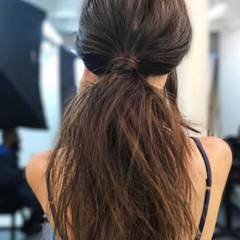 Arched bangs are cut in the form of an arch