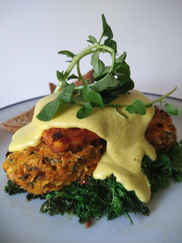 Vegan Benny with smoky bacon tofu, hollandaise and wilted greens