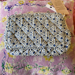 HAND-PRINTED SILK MAKE-UP BAG IN BLUE GEO