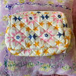 HAND-PRINTED SILK MAKE-UP BAG IN STAR PRINT