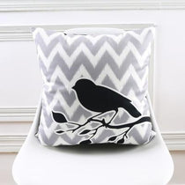 Gray and Black Nordic Bird on a Branch Throw Pillow