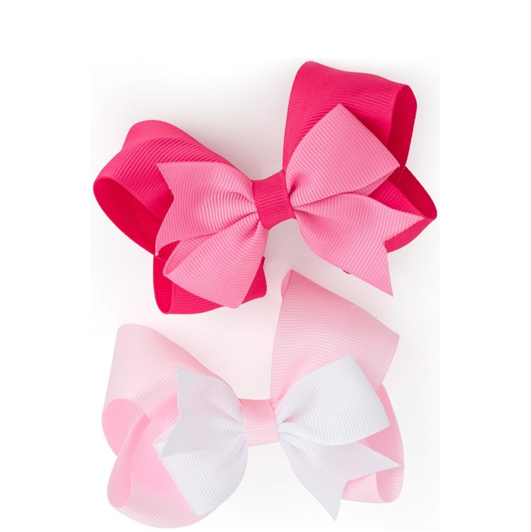 Two piece two tone pink bow hair clip set