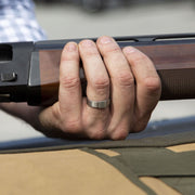 Holding a shotgun while wearing a Silver Platinum XL Barrel Band