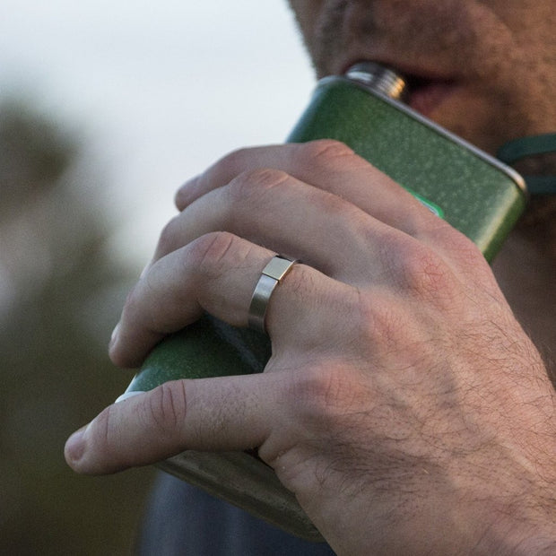 Wearing a Silver Platinum Classic Barrel Band while drinking from a flask