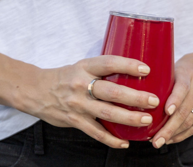 Holding a glass of wine while wearing a Women's Barrel Band with Rose Gold