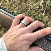 The Classic 5mm Barrel Band with a white gold insert holding a shotgun.