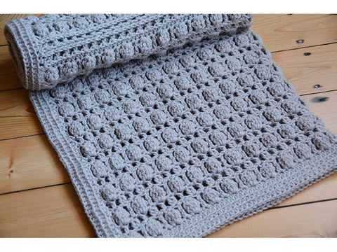 Oyster Shells Blanket by Hannah Cross in Deramores Studio Baby DK