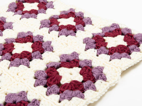 Small Granny Squares Cushion by Zoë Potrac in Deramores Studio Chunky (TV Bundle)