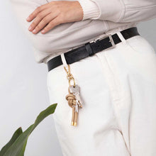 Charger l'image dans la galerie, Model with a KNOK Key Knot in gold attached to her belt loop