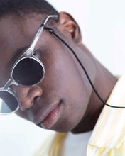 Charger l'image dans la galerie, Model wearing clear sunglasses with KNOK Glasses Chain in Black attached