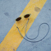 Charger l'image dans la galerie, KNOK glasses chain in grey leather with yellow sunglasses