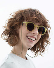Load image into Gallery viewer, Model wearing yellow sunglasses with KNOK Glasses Chain in olive green