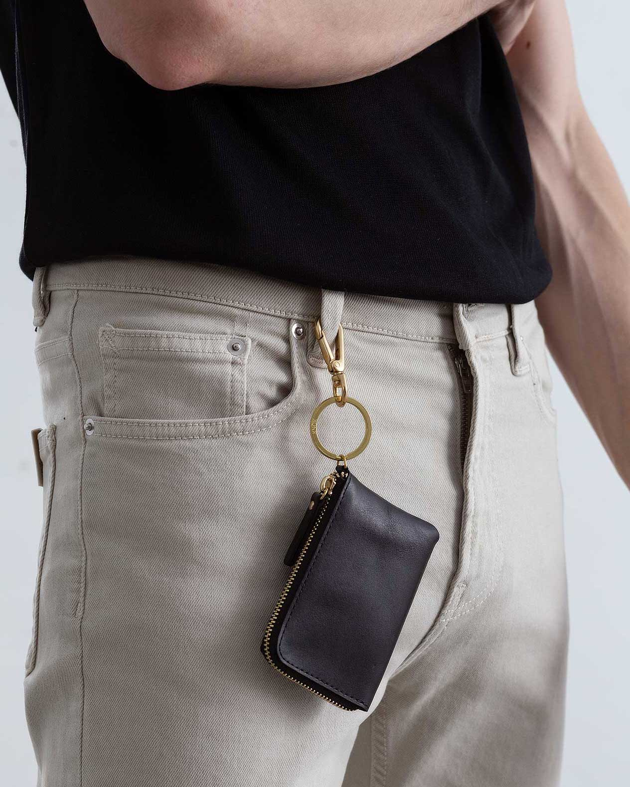 Model with KNOK XS Wallet with Key Hook attached to belt loop on jeans