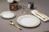 set of gold rimmed [plastic dinnerware