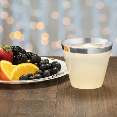 silver rim cup with fruits and drinks