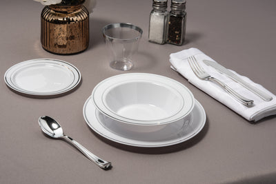 set of Silver Rimmed white Bowls plates cups and cutlery