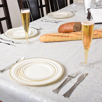 Champagne cups on a table with gold plates