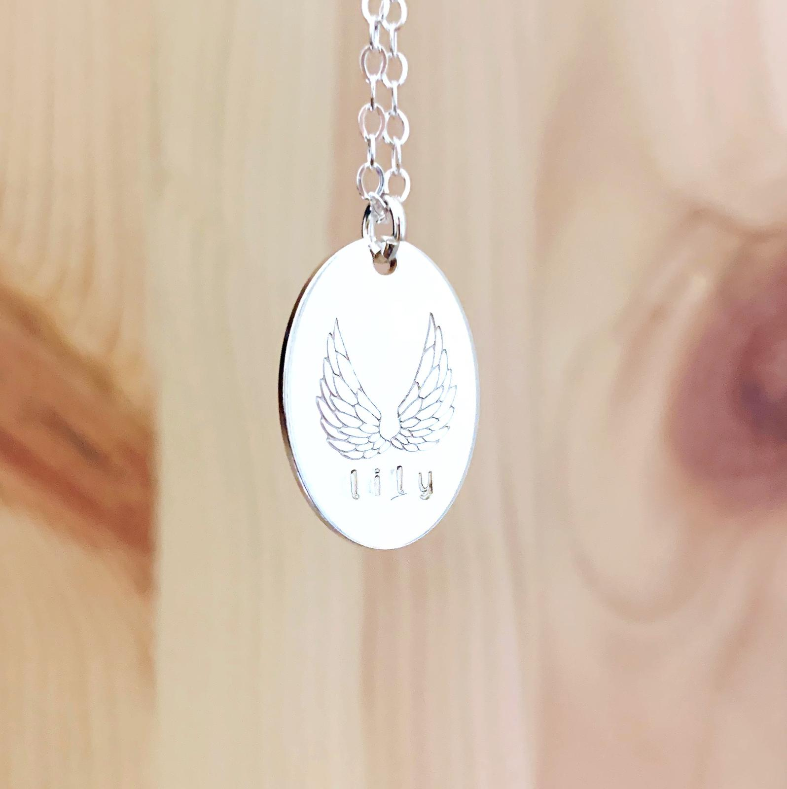 Angel Wings Necklace - Oval Disc