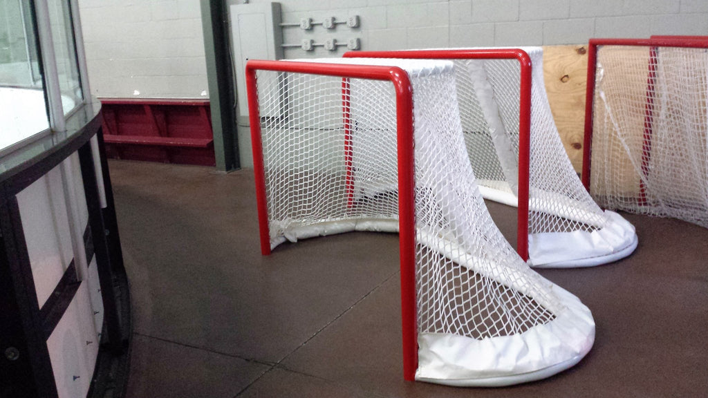 Ice Hockey goal fender on regulation nets