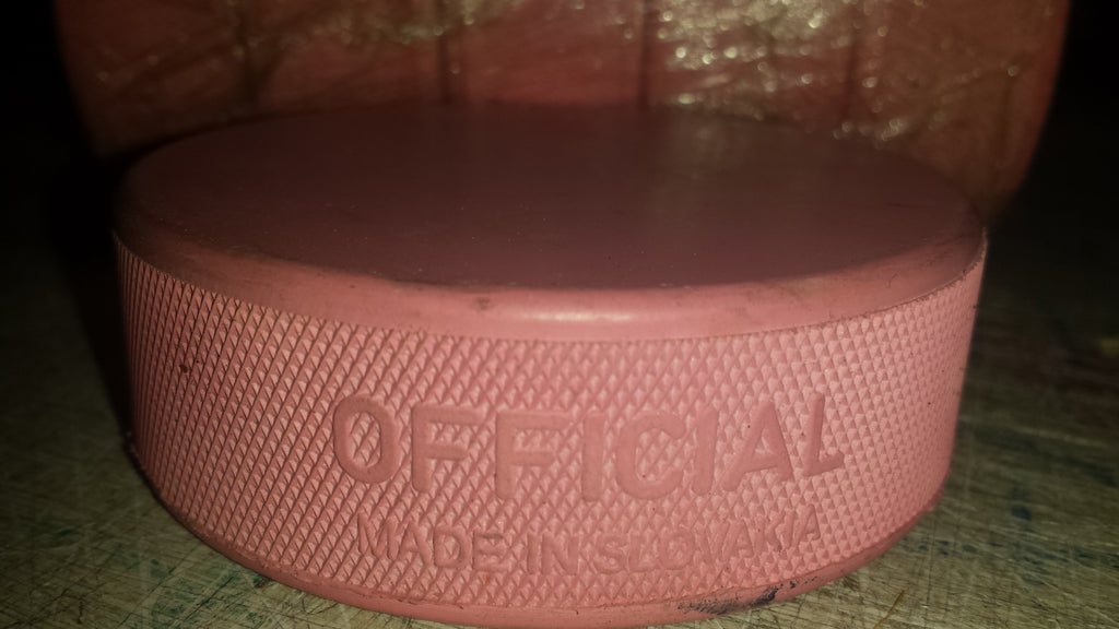 pink Ice Hockey puck
