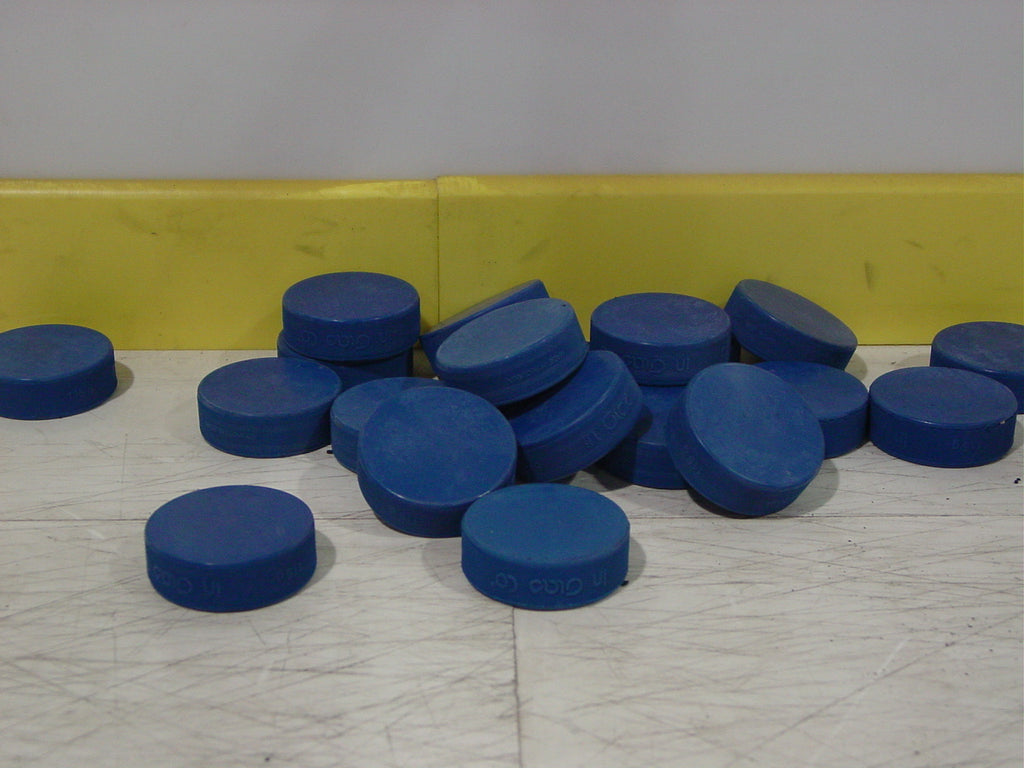 Blue ADM 8U ice hockey pucks