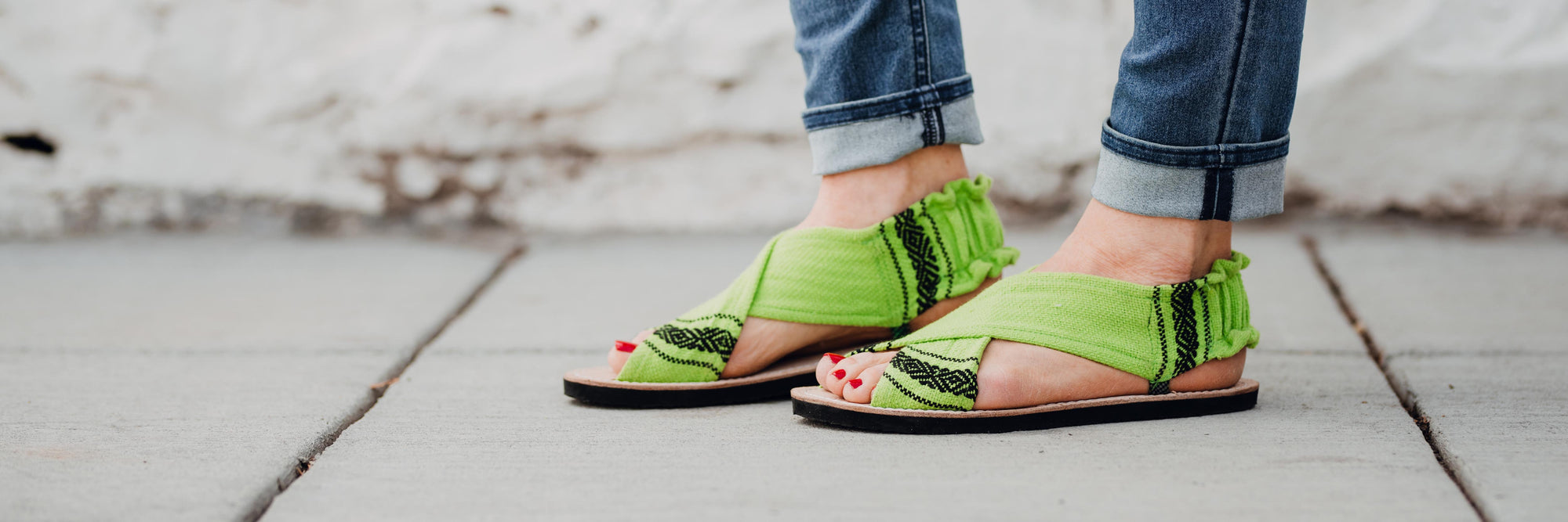 Lime green sandals that were handmade in Oaxaca, Mexico.