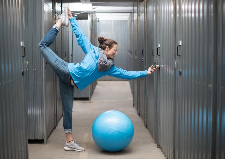 Woman doing yoga and opening a self-storage.