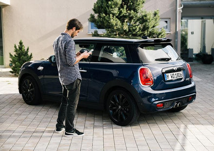 Man opening his car with an app.