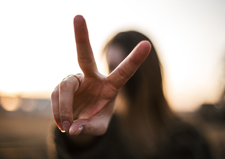 Photography of woman hand with peace sign