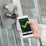 Smartphone in front of a smart lock