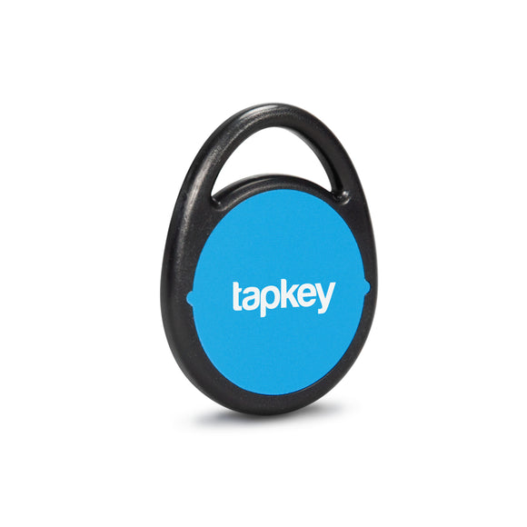 Round, blue NFC Tag with the Tapkey logo on it.