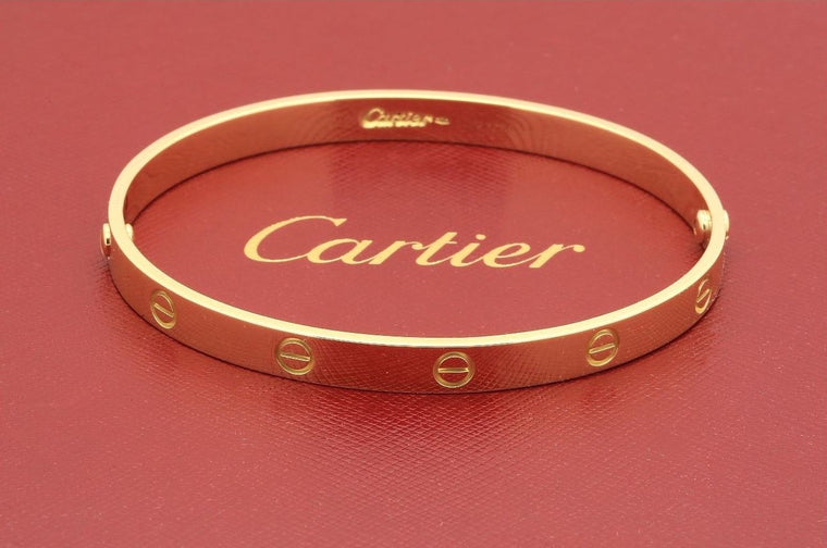 Cartier Love bracelet in 18k yellow gold size 21 classic screw system