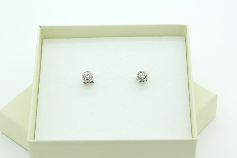 Halo Stud Diamond Earrings in 18k White Gold with a Total of 0.66 carat